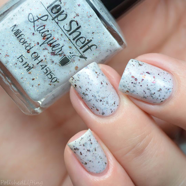white crelly nail polish with flakies