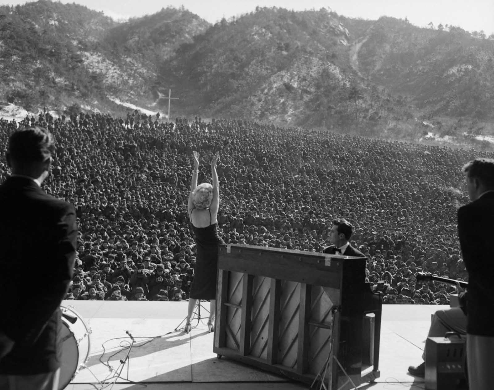 Marilyn Monroe on stage in front of thousands of troops Korea, 1954.