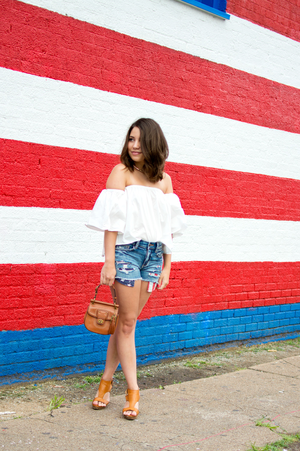 4th of July Outfit idea with american flag cutoff shorts and white off the shoulder top