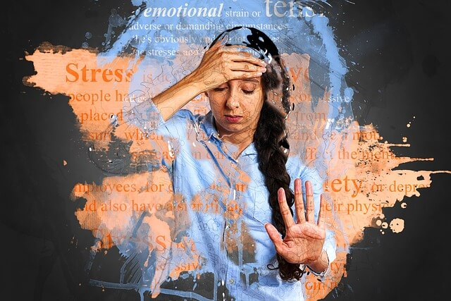 Woman stressed out, worried, hand on forehead