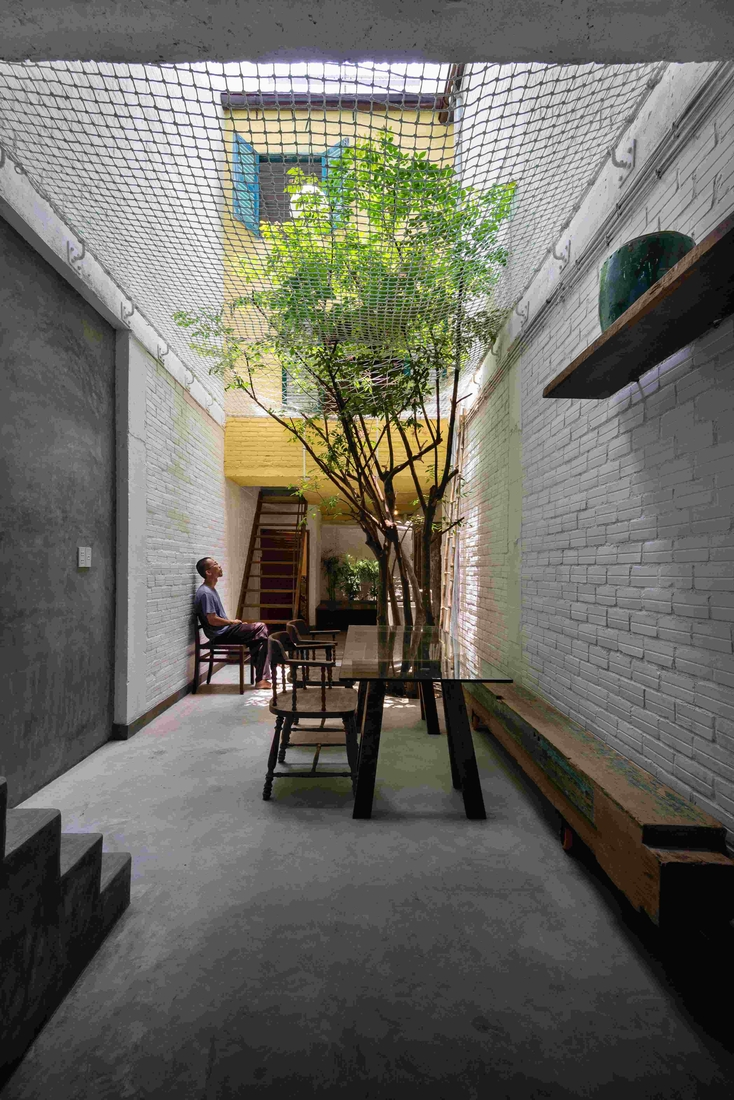 02-a21Studio-A-Home-Where-the-Rooms-Look-Like-a-small-Village-www-designstack-co