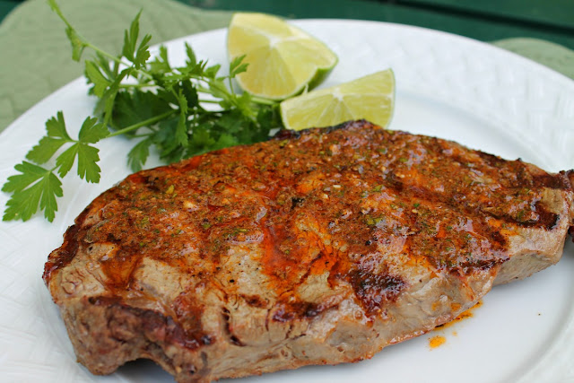 ... grilled steak seasoned with a cumin-spice rub and chili-lime butter