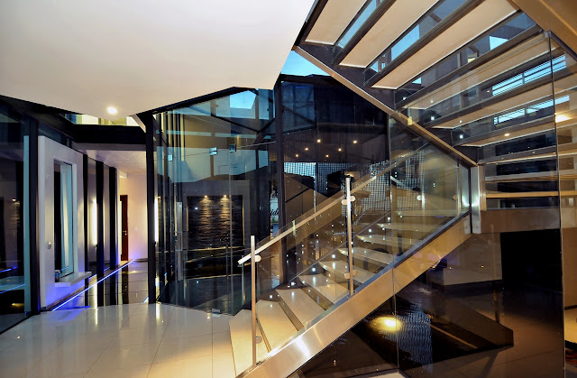 Glass staircase to the upper floor