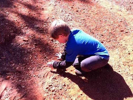 namc montessori sensorial work with soil exploring earth boy playing with dirt