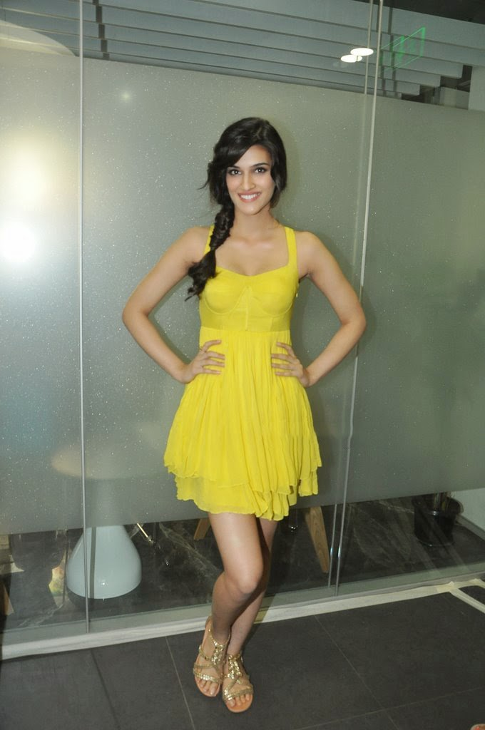 Kriti Sanon Hot Thigh Show Photos In Yellow Top