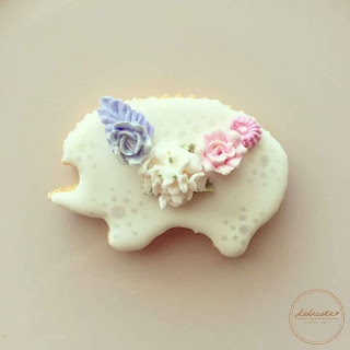 hedgehod cookie decorated with natural food coloured piped icing flowers