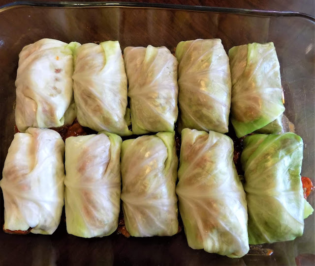 A picture of a dish with freshly made cabbage rolls