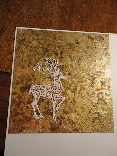 Gold and copper gilded sheet with die cut white reindeer