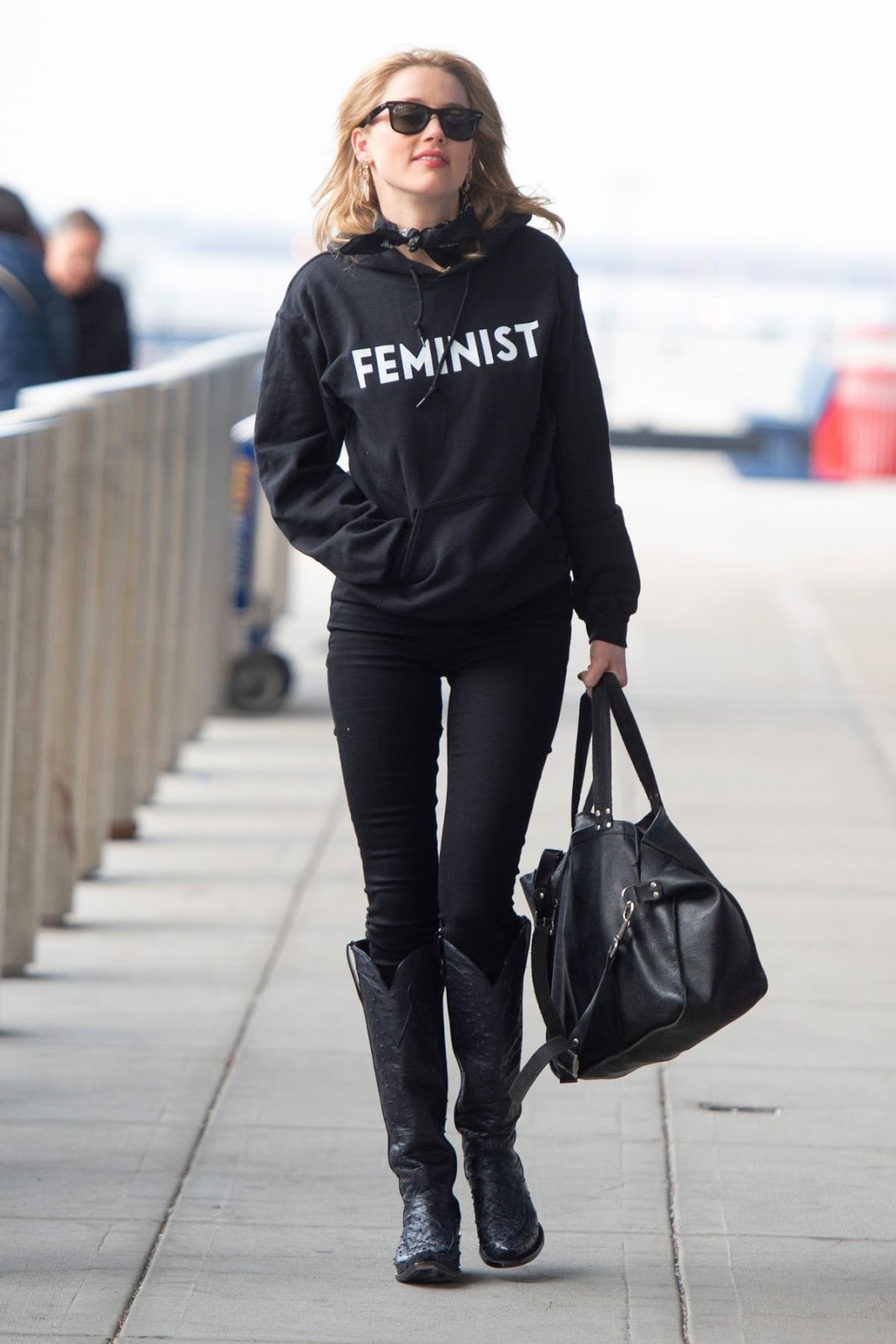 Amber Heard wears Feminist hoodie at JKF Airport