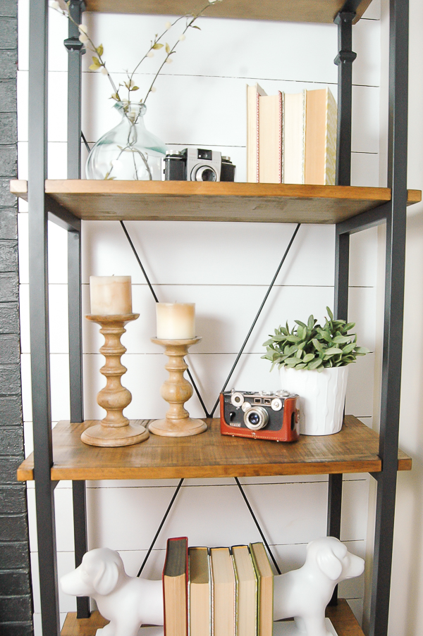 Styled bookcase with natural wood candle holders