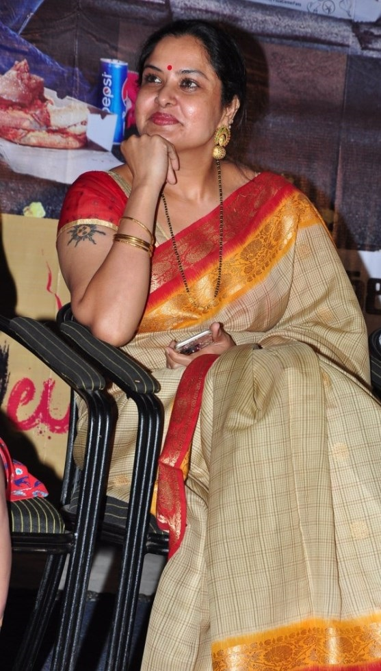 Tollywood Actress Pragathi Aunty Stills In Yellow Saree