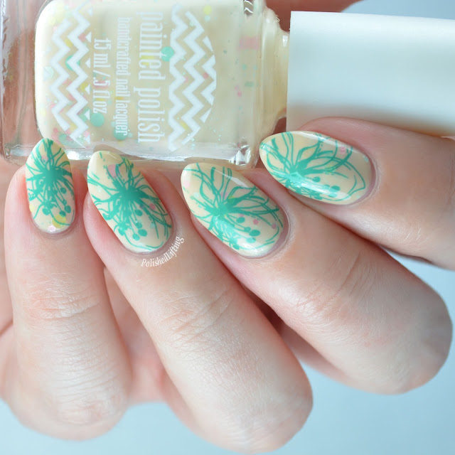 Creme nail polish with floral stamping