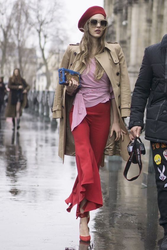 street style outfit red ruffle pants red beret trench coat