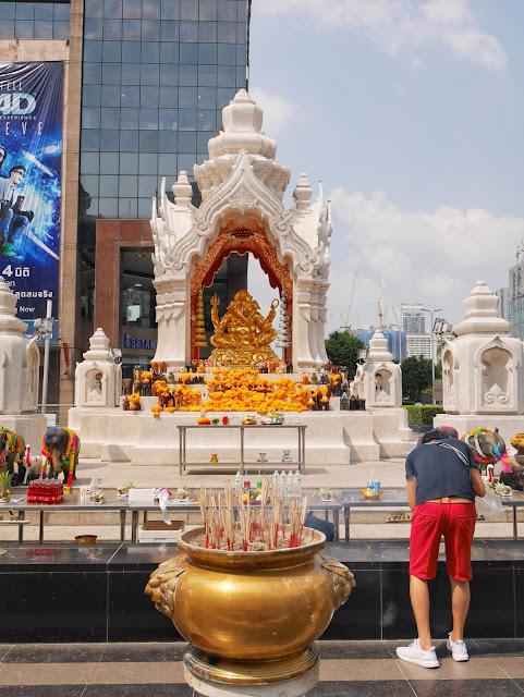 a man praying to the god Ganesha in Bangkok
