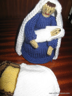 knitted Mary, baby and the manger with its rug.  Knitted Nativity pieces.