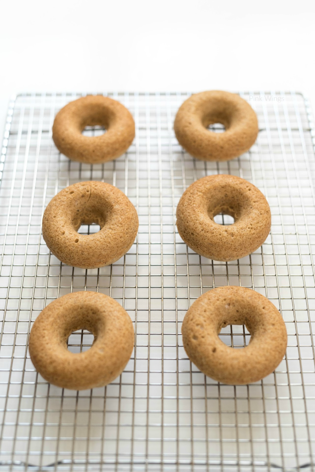 perfectly shaped donuts, how to make baked donuts, how to use a donut pan, best baked donut recipe, doughnuts, spiced cake, cake donuts recipe
