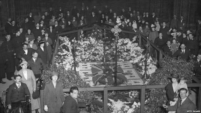 The ceremony to seal the grave of the unknown warrior in Westminster Abbey