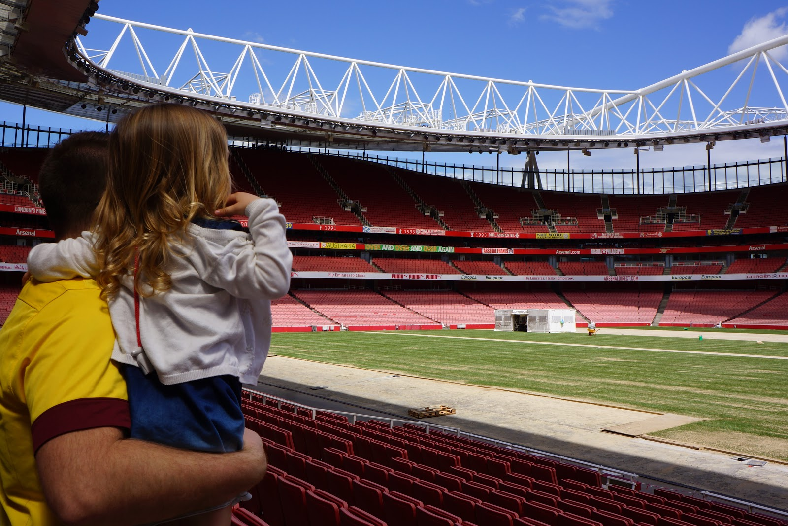 dad and daughter looking at the pitch at Arsenal Stadium