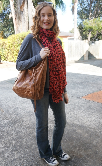 Away From Blue Flared jeans in winter neon leopard print scarf Balenciaga day bag