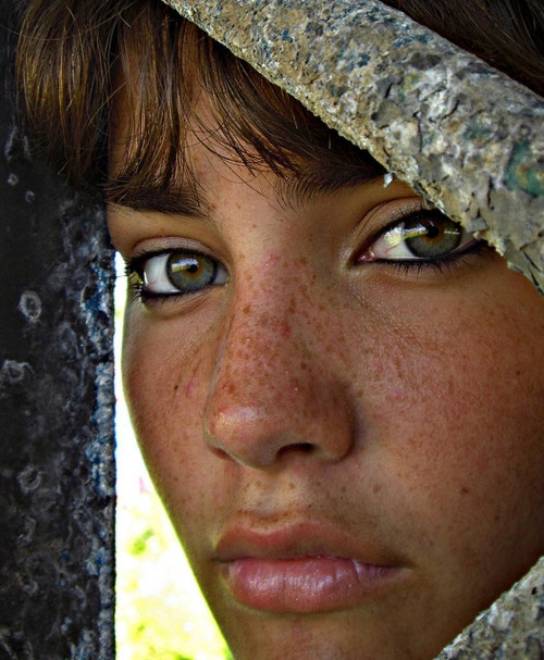 Exotic green eyes ebony teen showing her skills