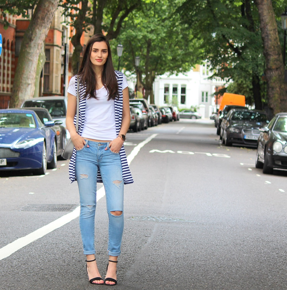 fbb43935750a0 peexo fashion blogger wearing white tshirt and ripped jeans and strappy  heels and striped sleeveless vest
