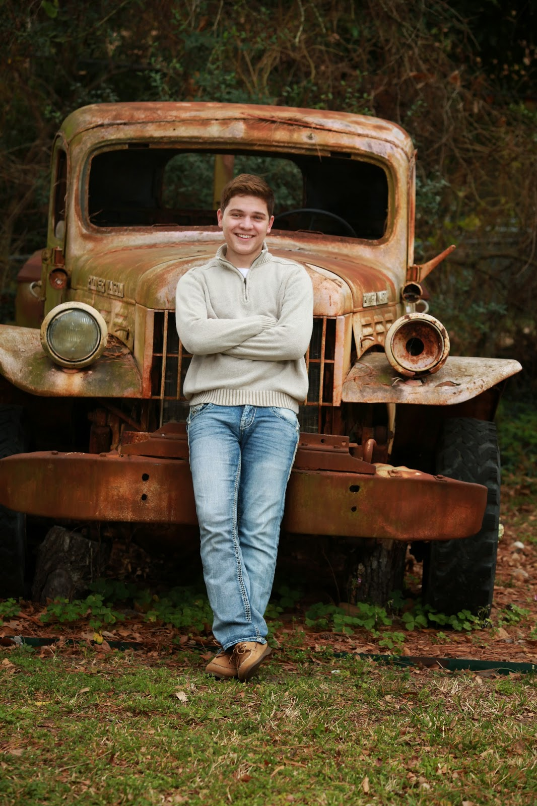 Siobhan Photography Senior Guy on Rustic Truck