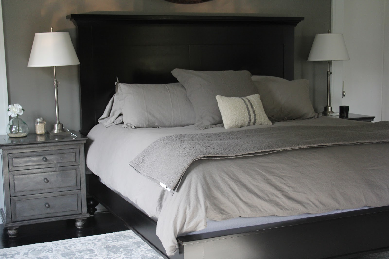 Elegant modern black and grey modern farmhouse bedroom on Hello Lovely Studio