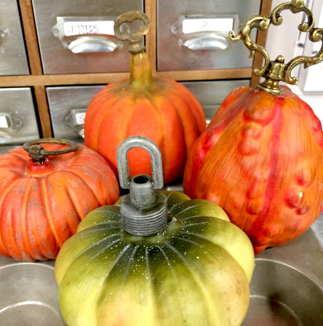 Dollar store pumpkins with added hardware stems