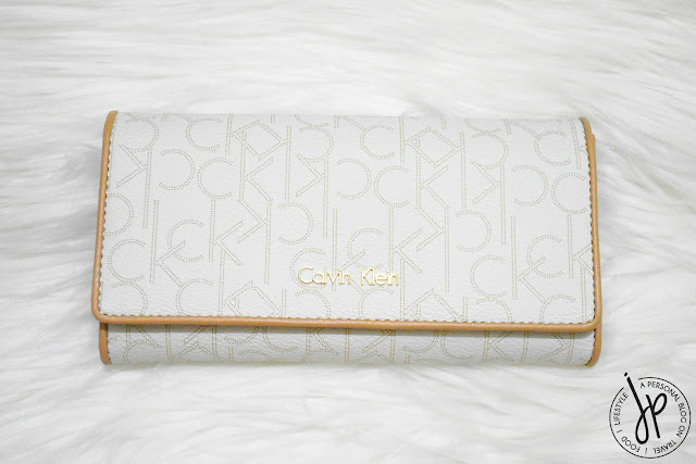 white long wallet with ck print