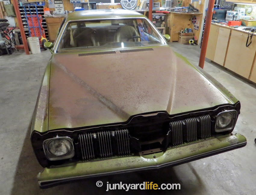 Front nose is missing on the 1973 Pontiac Grand Am in Golden Olive paint. New soft Endura nose is needed.