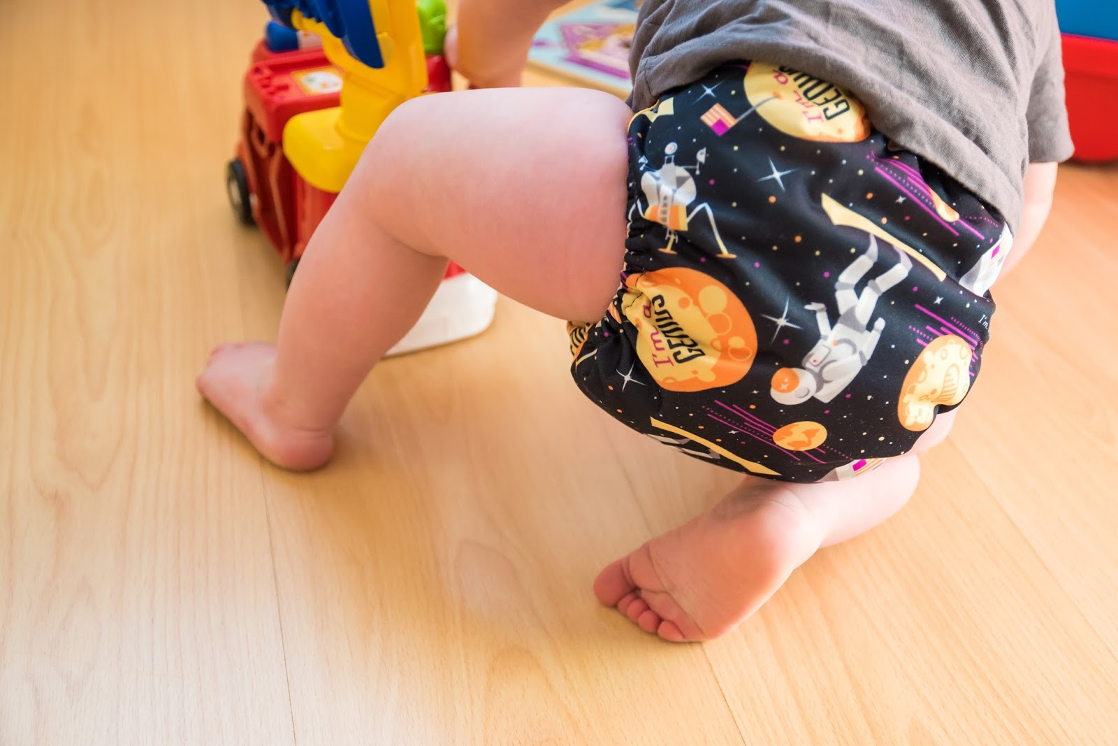 toddler playing in playroom wearing bumgenius cloth nappy