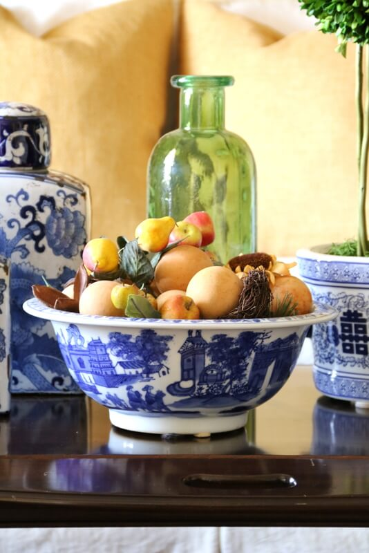 blue and white bowl with fruit