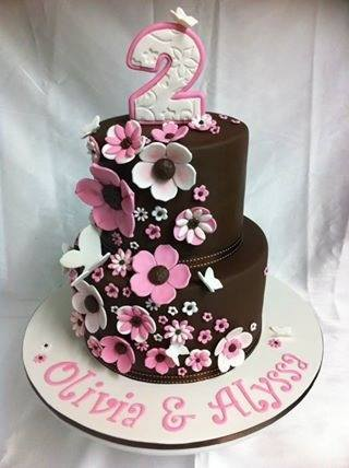 Flowers on chocolate tiered cake by Mardie Makes Cakes Cairns