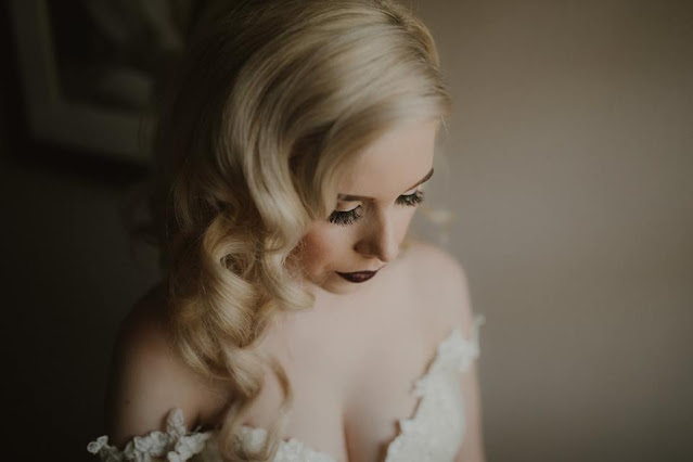 bride with curls and dark lips