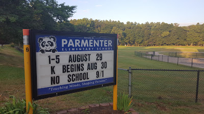 Parmenter School sign with the school opening dates