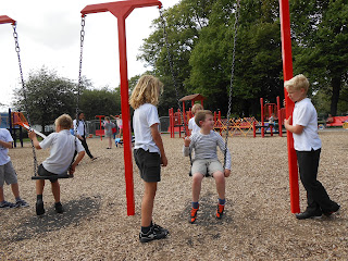 schoolboys playing on swings