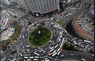 A roundabout with a lot of traffic, gridlocked