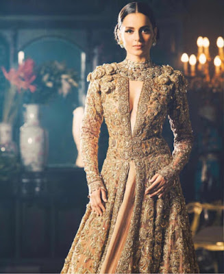 Bollywood Famous Actress And Model Kangana Ranaut Looking Gorgeous In Fancy Style Wedding Dress..