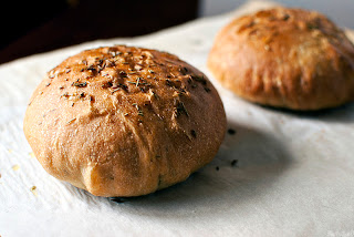 2 loaves of rosemary bread on parchment paper