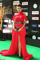 Apoorva in a Stunning Tight Leg Split Sleeveless Red Gown at IIFA Utsavam Awards 75.JPG