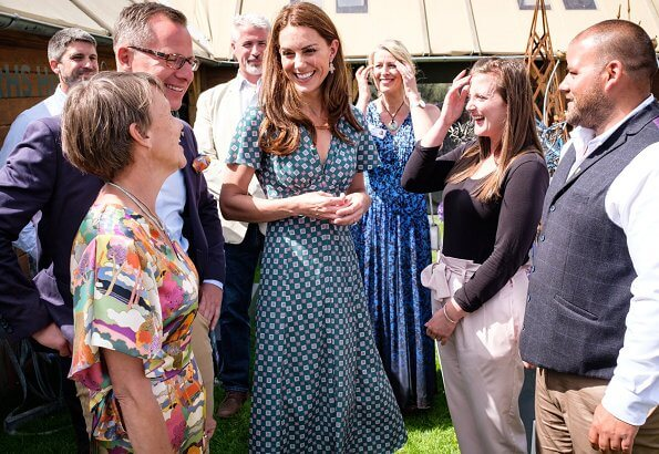 Kate Middleton wore a short sleeved printed dress by Sandro, Castaner Carina wedge, Accessorize polly petal drop earrings