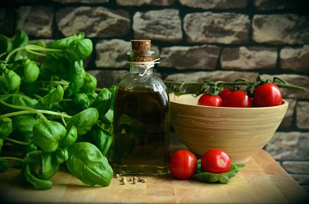 Basil with a bowl of tomatoes