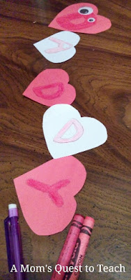Hearts with the letters for Daddy on them for craft