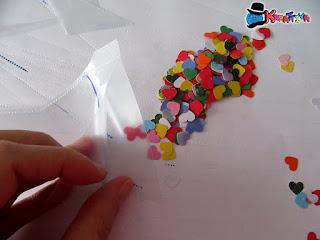 riempi con cuoricini di carta