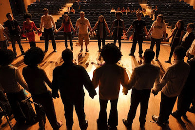 Group of People Holding Hands and Standing in a Circle