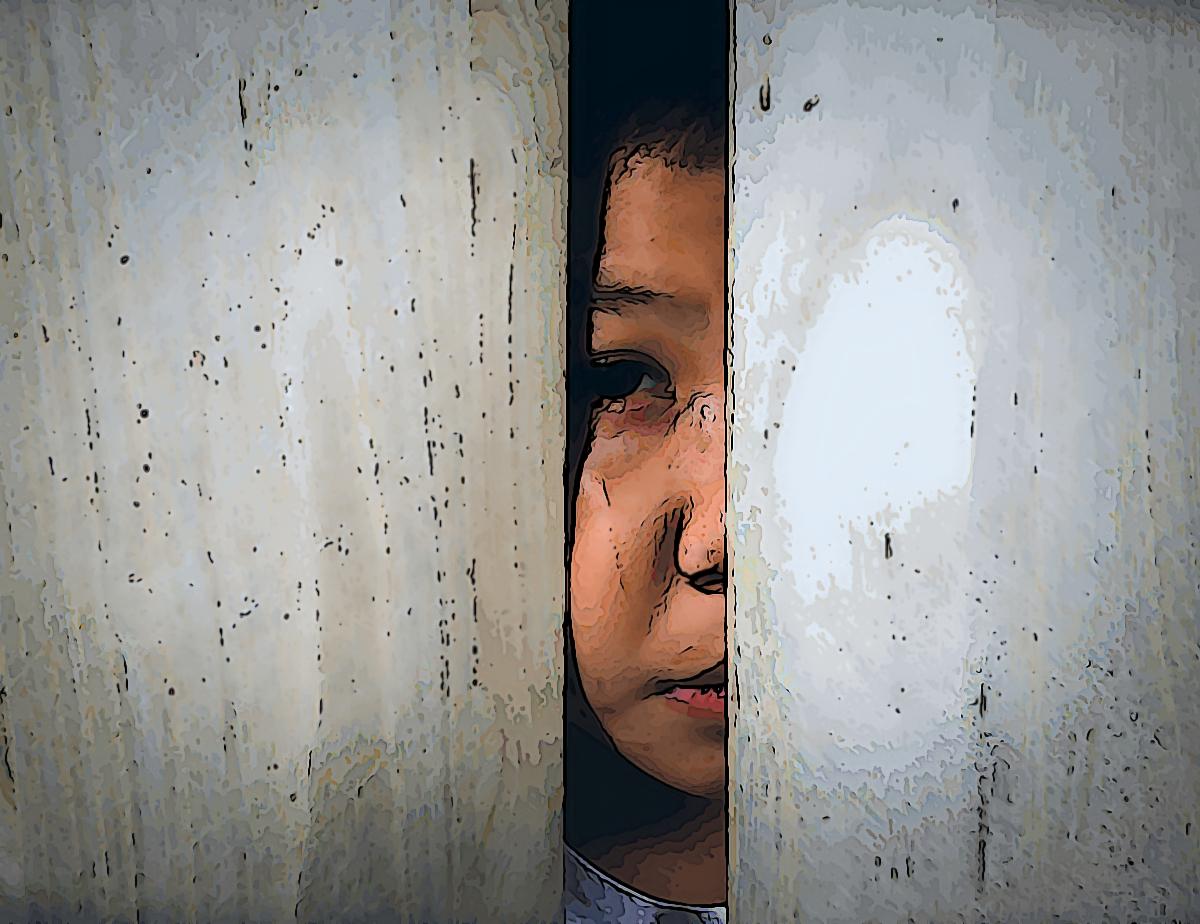 child peeking through door