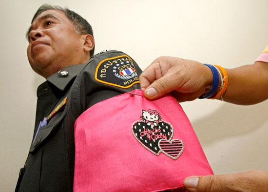 Hello Kitty armbands to shame misbehaving Thai police