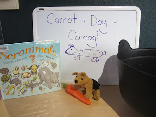 a copy of the book Scranimals, a tiny stuffed dog, a plastic carrot, a drawing of a Carrot + Dog= Carrog, a soup pot