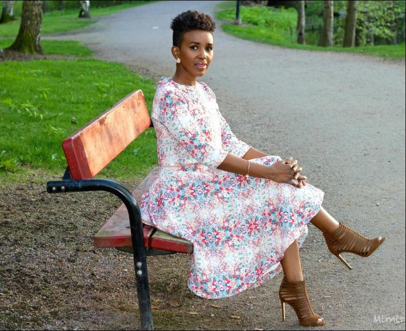 black woman in flowery oufit