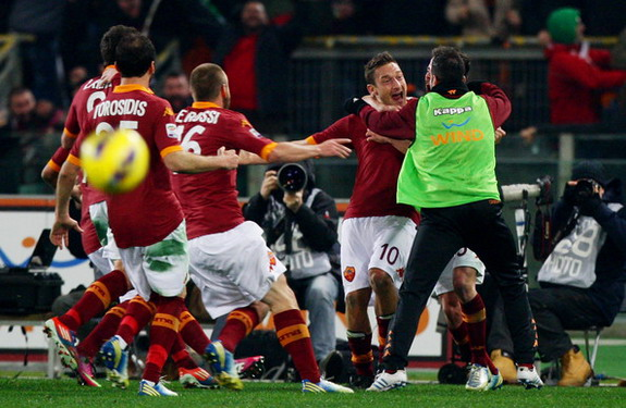AS Roma captain Francesco Totti celebrates with teammates after scoring against Juventus